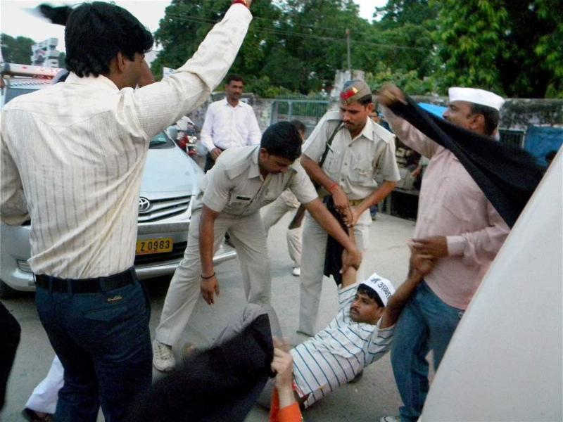 Policemen beat supporters of Anna Hazare's anti-corruption movement while they were showing black flags to Union minister Salman Khurshid during his two-day visit to his parliamentary constituency Farrukhabad.