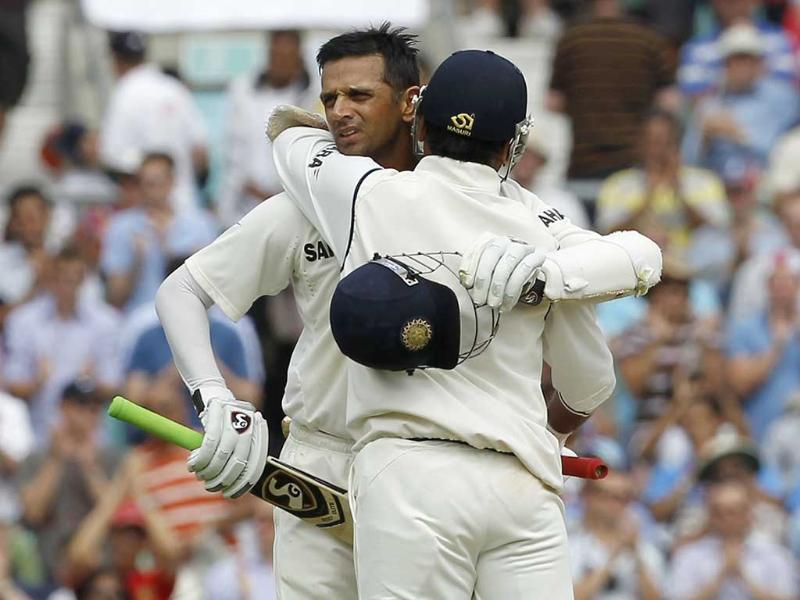 Rahul Dravid celebrates reaching 100 runs with Amit Mishra during day 4 of the fourth Test match between England and India at The Oval Cricket Ground in London.