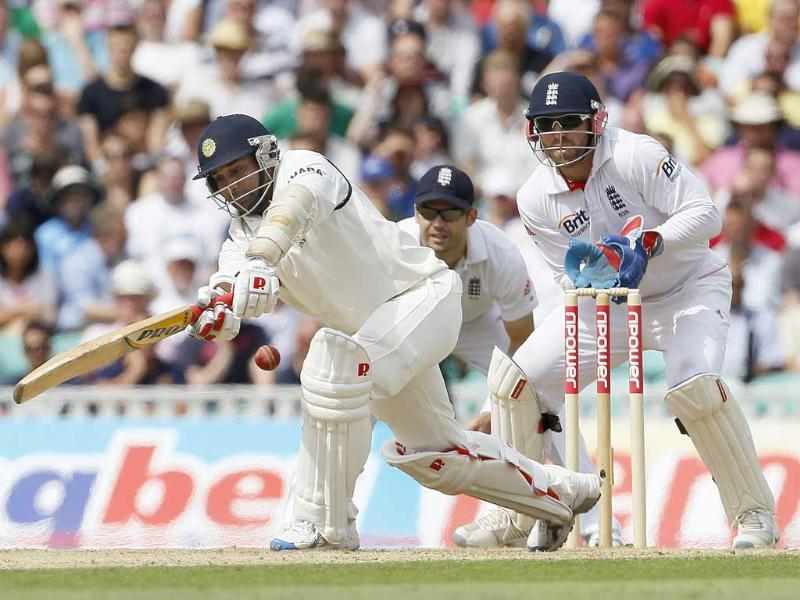 Amit Mishra plays a shot off the bowling of England's Graeme Swann in their fourth Test match at The Oval cricket ground in London.
