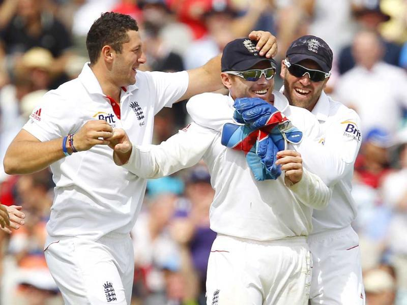England's Ian Bell celebrates catching out Amit Mishra for 43 runs with wicketkeeper Matt Prior during day 4 of their fourth Test match against India at The Oval Cricket Ground in London.