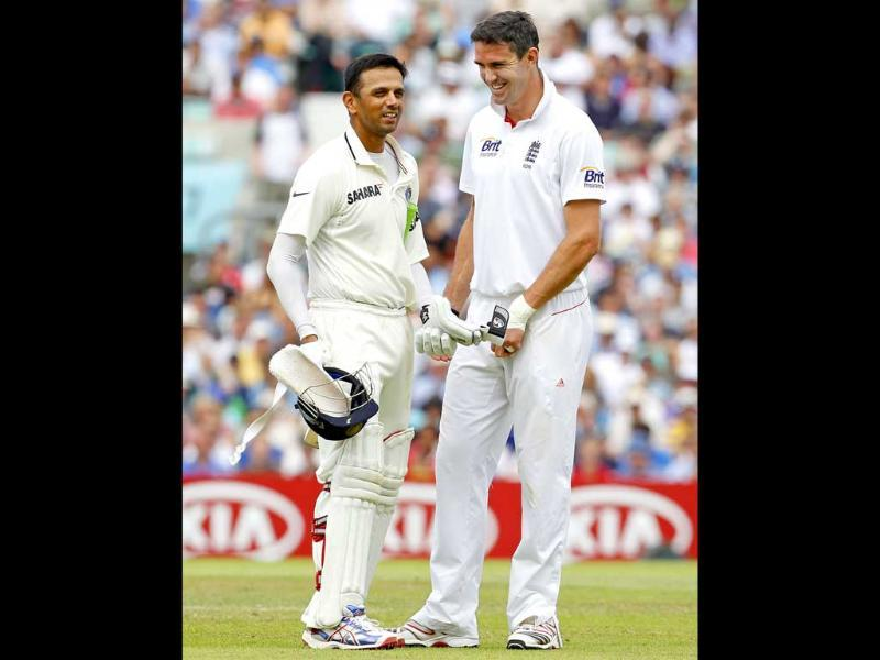 Rahul Dravid talks with Kevin Pietersen during day 4 of the fourth Test match between England and India at The Oval Cricket Ground in London.
