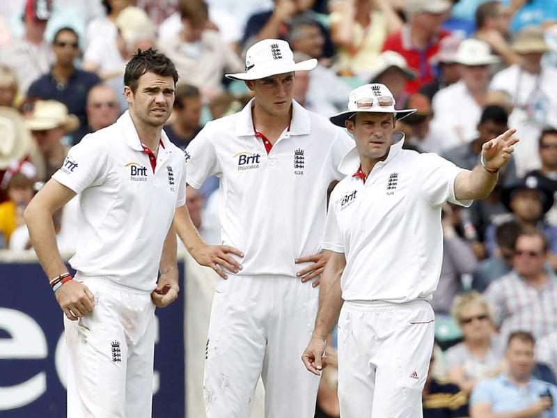 England's Captain Andrew Strauss talks to Stuart Broad and James Anderson between overs during day 4 of their fourth Test match against India at The Oval Cricket Ground in London.