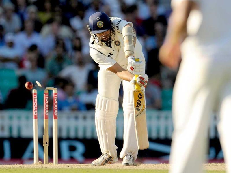 VVS Laxman is bowled by England's James Anderson during their fourth Test cricket match at the Oval cricket ground in London.