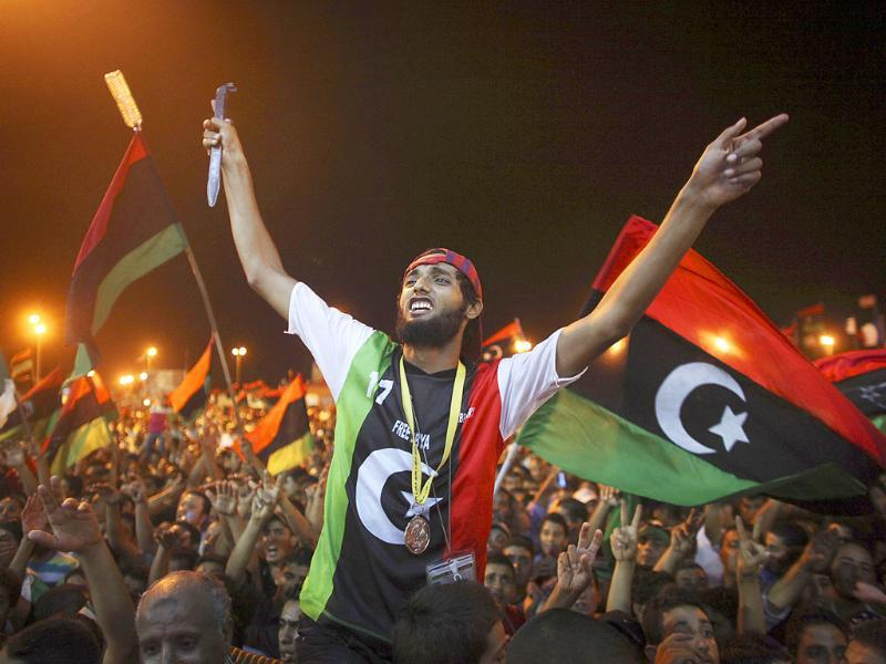 People celebrate the capture in Tripoli of Muammar Gaddafi's son and one-time heir apparent, Seif al-Islam, at the rebel-held town of Benghazi, Libya.