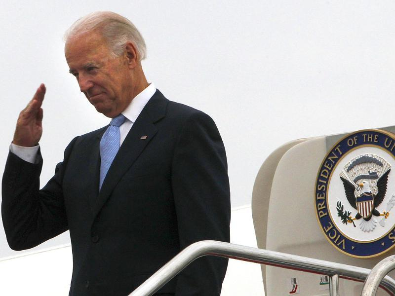 US vice president Joe Biden salutes to a send off party before boarding Air Force Two to depart for Mongolia from the airport in Chengdu, China.