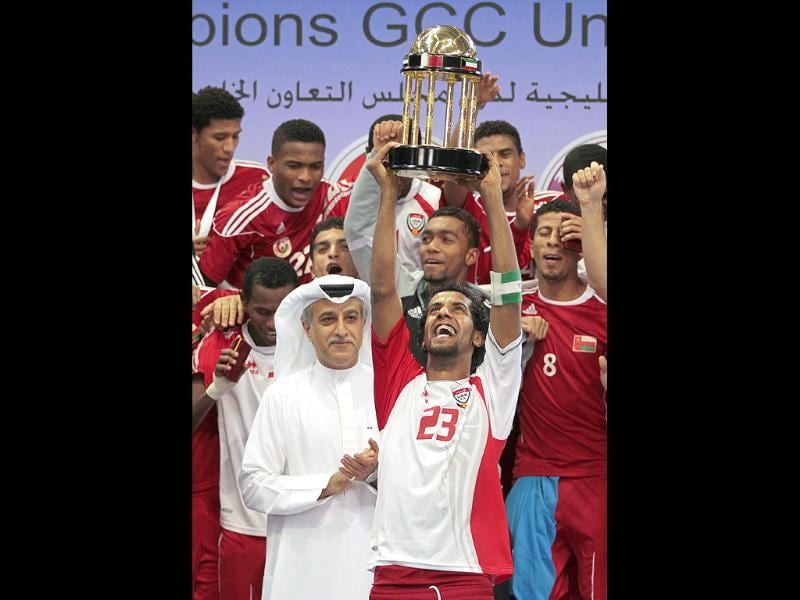 Oman's captain Mansur Salim holds aloft the trophy after Oman won their Gulf Cup Olympic Team Under-23 final soccer match against UAE in Doha.