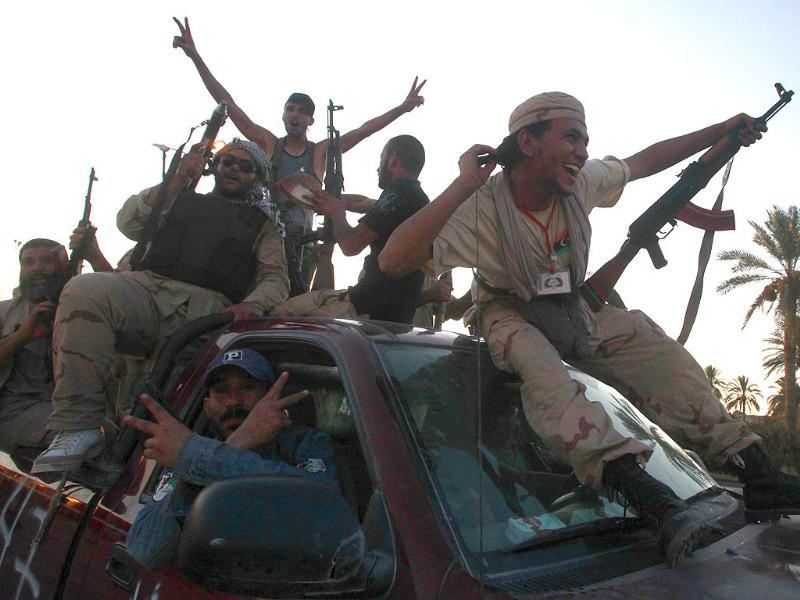 Libyan rebel fighters ride through the town of Maia celebrating after advancing to the outskirts of Tripoli.
