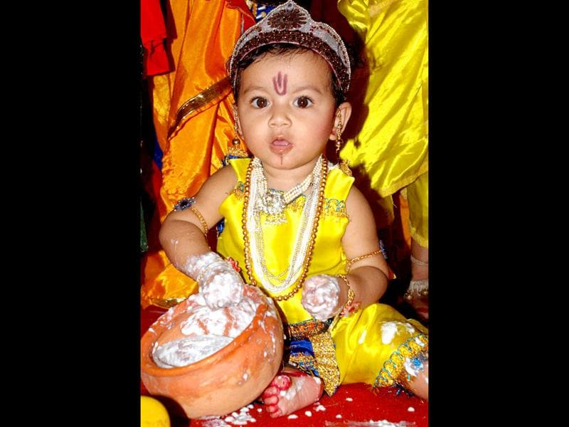 A kid dressed as Lord Krishna taking part in a competition on the occasion of Janmashtami in Guwahati.