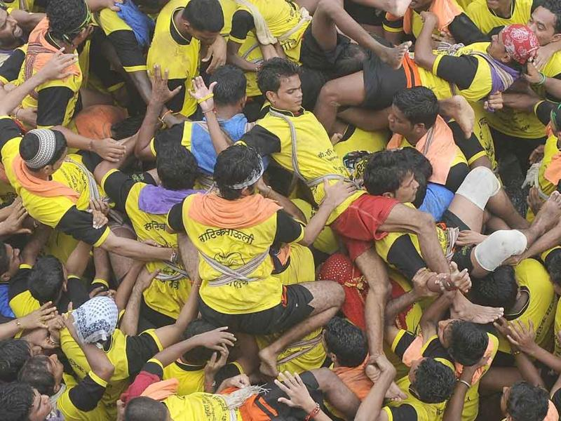 Hindu devotees fall on top of each other after forming a human pyramid in an attempt break the dahi-handi in Mumbai.