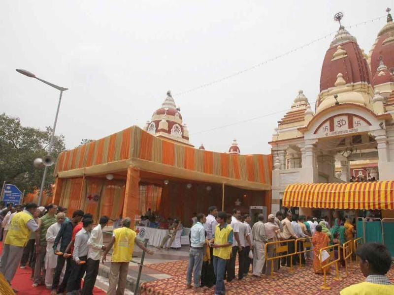People arrive to attend Krishna Janmashtami celebrations at Laxmi Narayan Temple (Birla Mandir), in New Delhi.