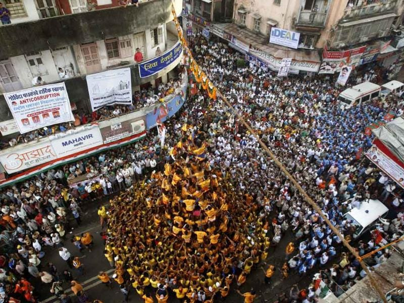 People aim to break the dahi handi as they celebrate Janamashtami in Mumbai.