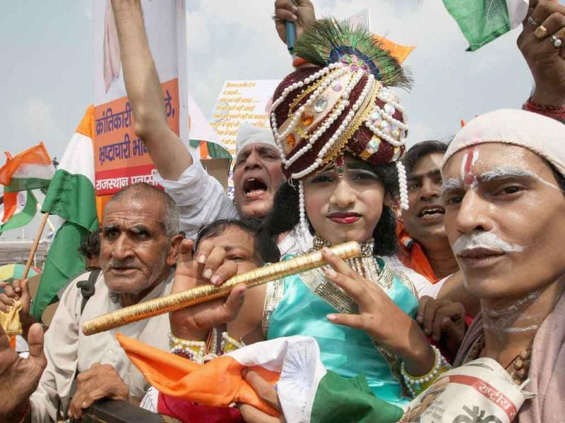 Anna Hazare supporters dressed up as Krishna and Sudama during their protest against corruption at Ramlila Maidan in New Delhi.