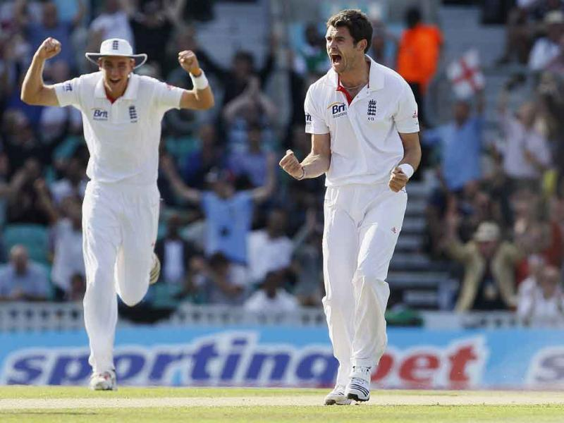 England's James Anderson (C) celebrates with Stuart Broad after dismissing India's Virender Sehwag in their fourth Test match, at The Oval cricket ground in London.