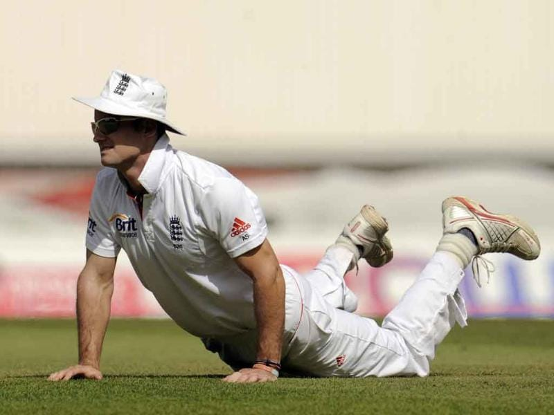 England's captain Andrew Strauss watches the ball from the ground during the fourth Test cricket match against India at the Oval cricket ground in London.