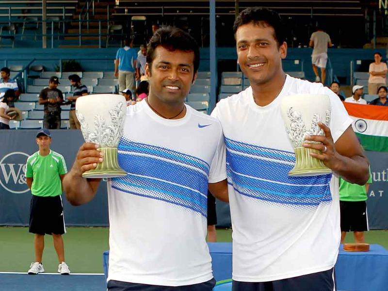 India's Leander Paes and Mahesh Bhupathi pose after defeating Michael Llodra and Nenad Zimonjic of Serbia during the final of the Western & Southern Open in Mason, Ohio.
