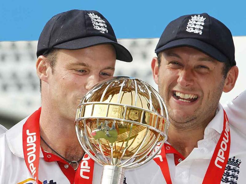 England's captain Andrew Strauss (L) kisses the ICC Test Mace, ranking England as the number one Test team, as Tim Bresnan looks on, after they beat India in the fourth Test by an innings and 8 runs at The Oval Cricket Ground in London.