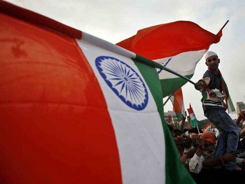 Supporters of anti-corruption activist Anna Hazare wave national flags at the fast venue in New Delhi.
