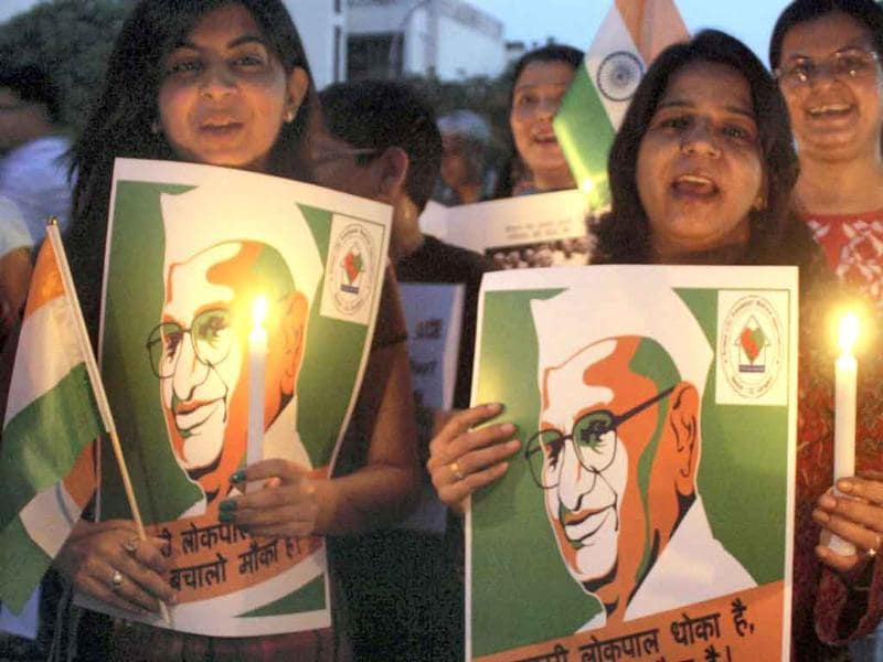 Supporters of Anna Hazare take part in a candle light march in favour of Jan Lokpal Bill in Gurgaon.