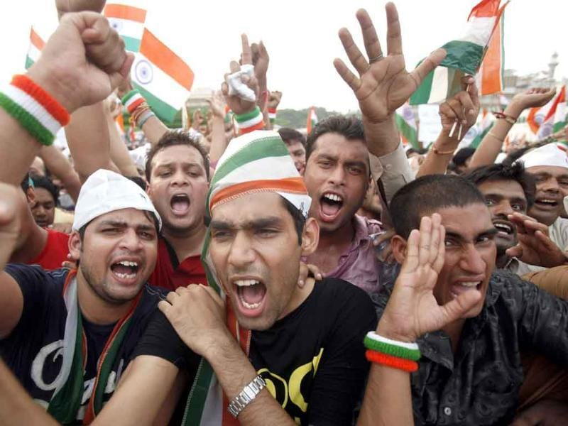 Supporters of Anna Hazare wave national flags and shout slogans at the fast venue in New Delhi.