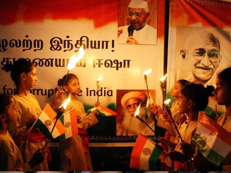 Supporters of social activist Anna Hazare take part in a candle light vigil in support of Jan Lokpal Bill in Coimbatore.