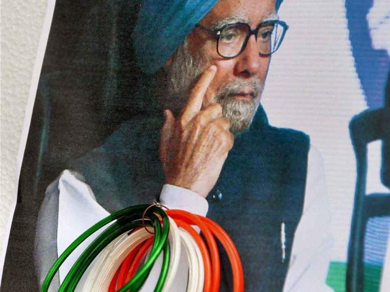 A supporter of Anna Hazare attaches bangles to a poster of Prime Minister Manmohan Singh during a protest outside the residence of Union minister Subodh Kant Sahay in Ranchi.