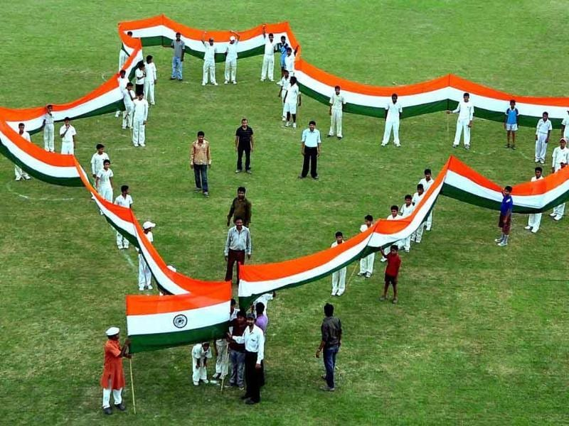 Supporters of social activist Anna Hazare make a shape of the Indian map with a Tricolour during a rally against corruption in Allahabad.