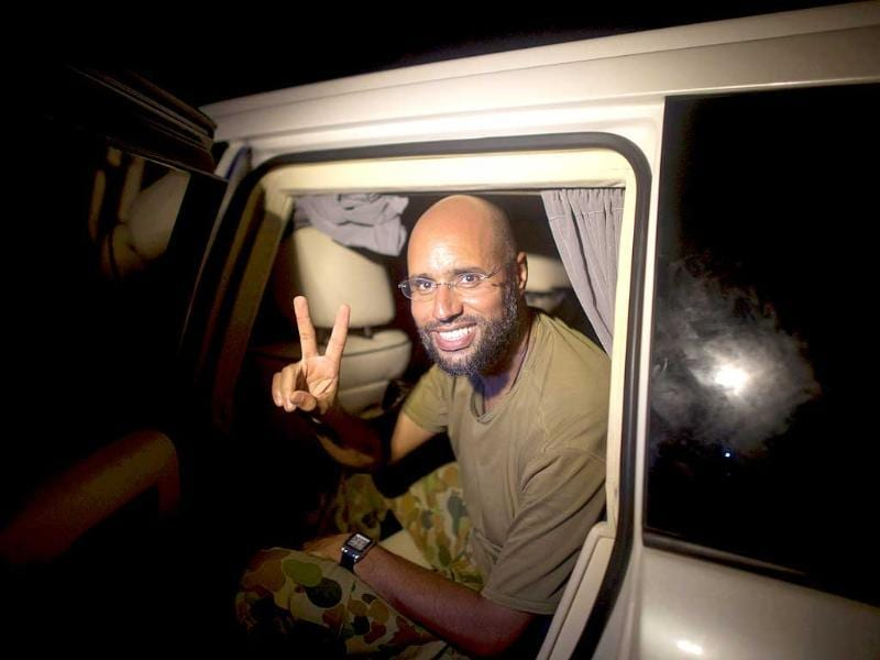 Saif al-Islam Gaddafi, son of Libyan leader Muammar Gaddafi, flashes the V-sign for victory as he appears in front of supporters and journalists in the Libyan capital Tripoli in the early hours of Tuesday.