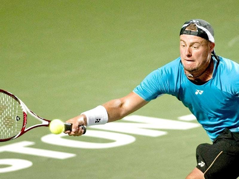Lleyton Hewitt of Australia returns a ball hit by Blaz Kavcic of Slovenia during a first round match at the Winston-Salem Open.