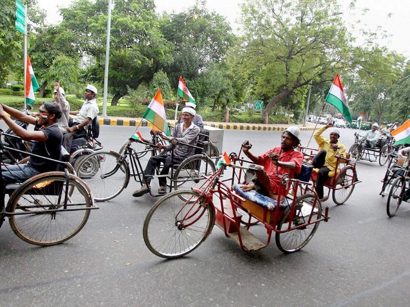 Physically challenged people take part in a protest rally in support of Anna Hazare's movement against corruption in New Delhi.