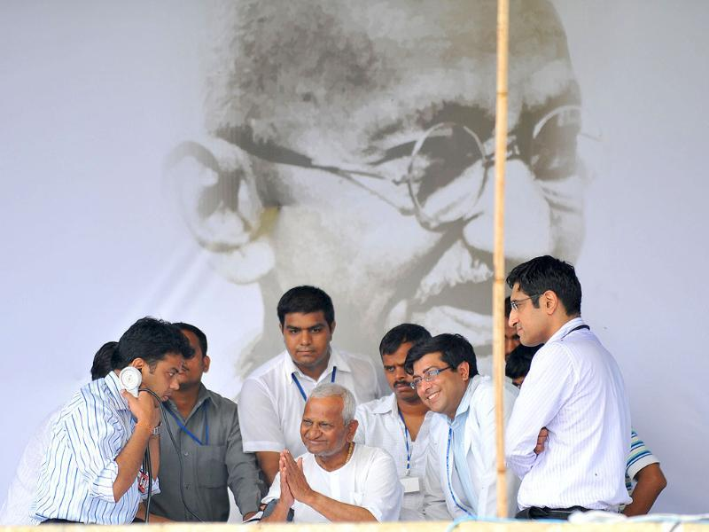 A team of doctors check Anna Hazare as he gestures towards his supporters during a rally at Ram Lila grounds in New Delhi.