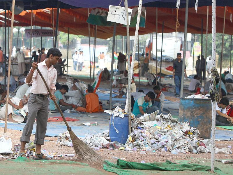 MCD workers clean Ramlila Maidan, the venue of of Anna Hazare's protest against corruption, in New Delhi.