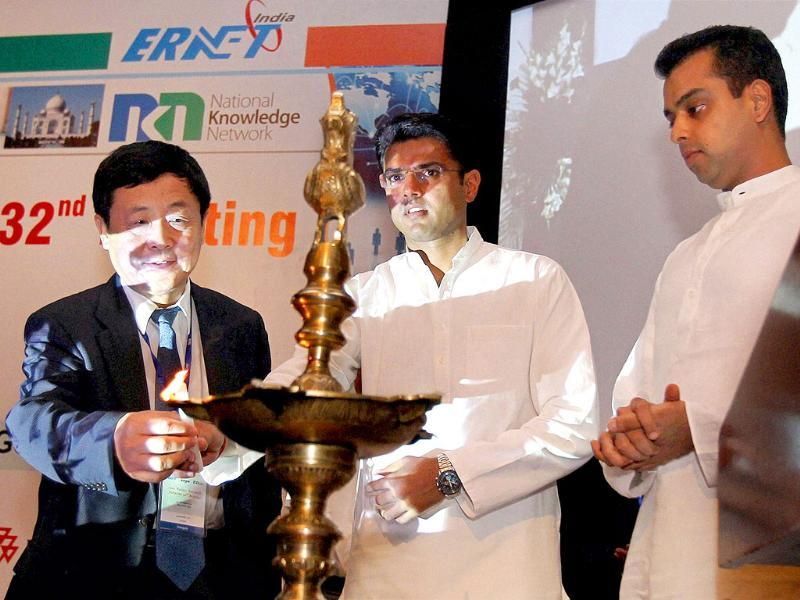 Ministers of state for communications and information technology, Sachin Pilot and Milind Deora light a lamp during the 32nd meeting of Asia Pacific Advance Network (APAN) in New Delhi.