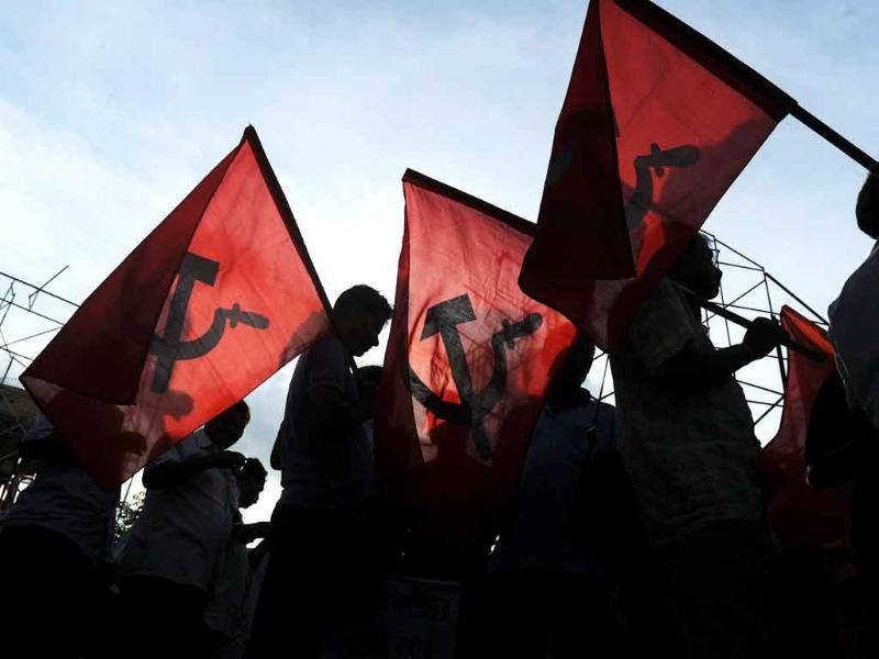 Left activists carry party flags as they participate in a mass rally organised by the Left Front in Kolkata to protest against the UPA and to support anti-corruption activist Anna Hazare.