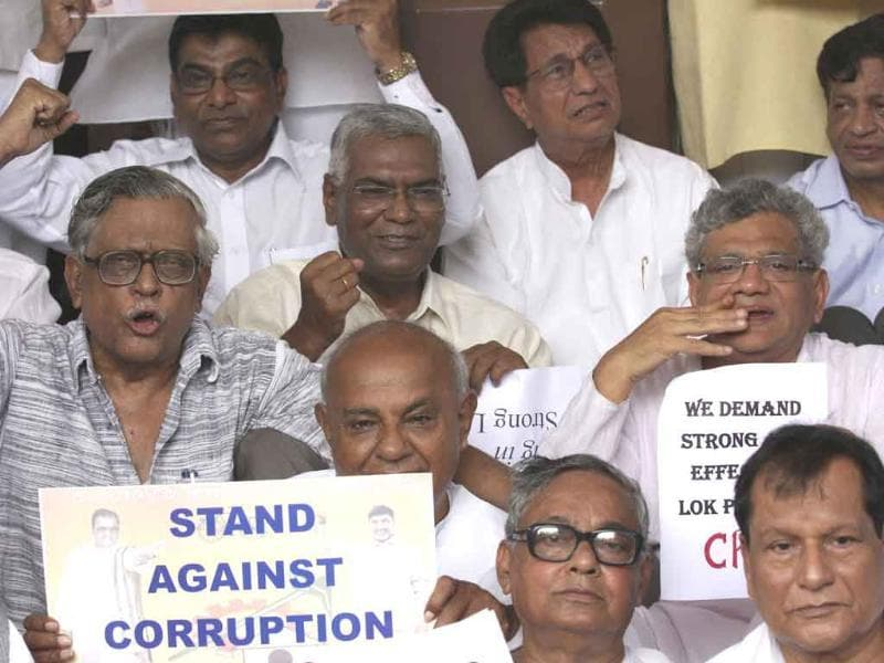 Opposition members including Communist Party of India (M) leader D Raja, CPI(M) politburo member Sitaram Techury and former Prime Minister Deve Gowda stage a sit-in demonstration against corruption and for a stronger Lokpal Bill outside the Parliament in New Delhi.