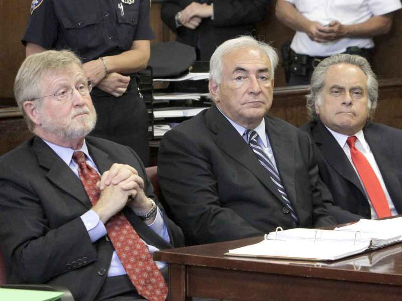 Former International Monetary Fund leader Dominique Strauss-Kahn (C) flanked by attorneys William Taylor (L) and Benjamin Brafman, listens to proceedings in Manhattan state Supreme Court in New York.
