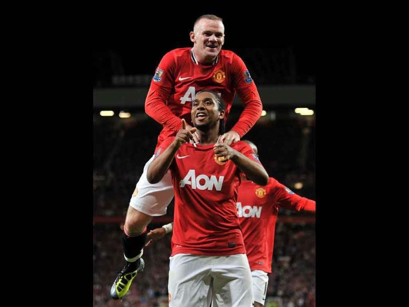 Manchester United's Anderson celebrates scoring the second goal against Tottenham Hotspur with Wayne Rooney during their Premier League match at Old Trafford, Manchester.