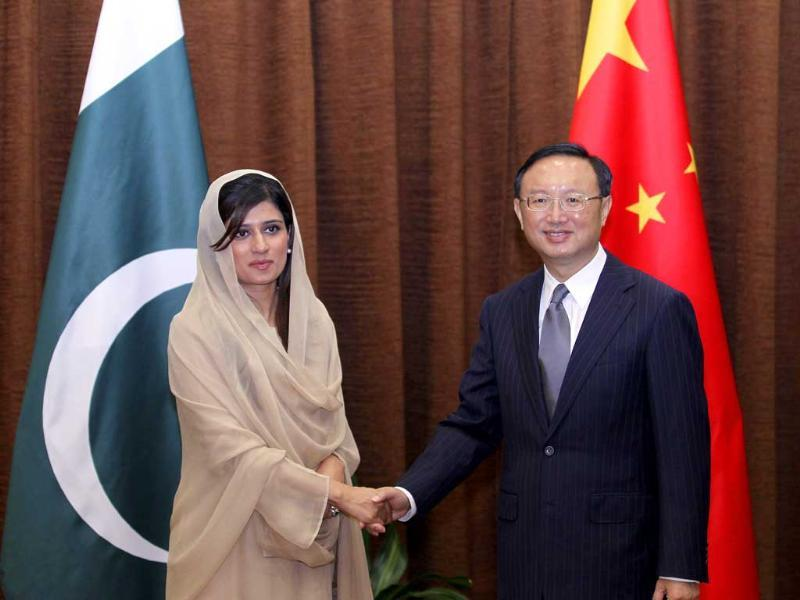 Pakistan's foreign minister Hina Rabbani Khar shakes hands with her Chinese counterpart Yang Jiechi at the ministry of foreign affairs in Beijing.