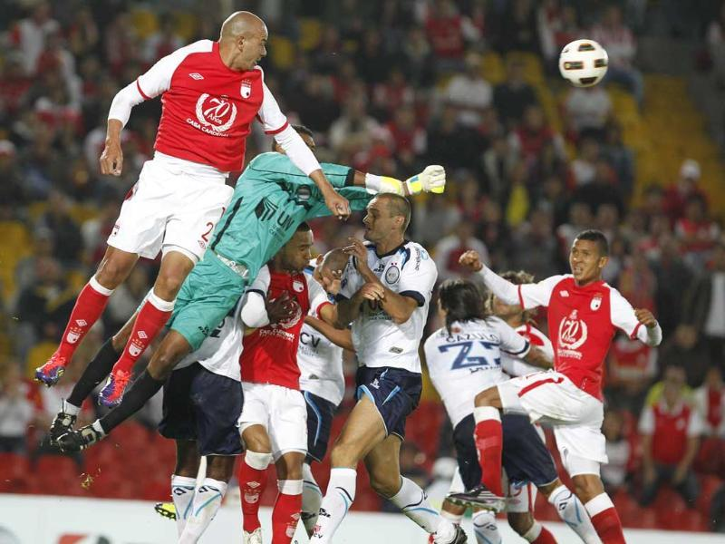 German Centurion (L) of Colombia's Independiente Santa Fe heads the ball during a Copa Sudamericana soccer game against Peru's University Cesar Vallejo in Bogota, Colombia.