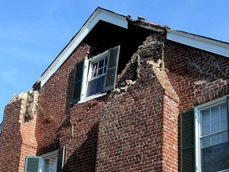 An historic home belonging to Jane and Percy Wootton is shown damaged by the early afternoon 5.8 earthquake whose epicenter was located nearby in Cockoo, Virginia.