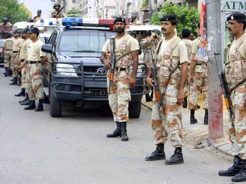Pakistani security personnel visit a troubled area during a crackdown operation against target killers and the extortion mafia in Karachi.