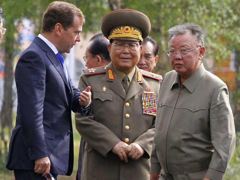 Russia's President Dmitry Medvedev shows the way to North Korean leader Kim Jong-il during their meeting at the