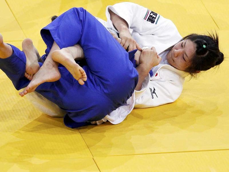 Misato Nakamura of Japan competes with Lea Farhat of Lebanon during their under 52 kg women's elimination bout at the World Judo Championships in Paris.