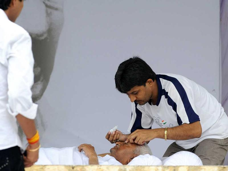 Anna Hazare receives medical attention from a medic during his anti-corruption fast at Ram Lila grounds in New Delhi.