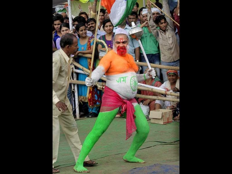 A supporter of Anna Hazare with colours of Indian national flag painted on his body shouts slogans on the ninth day of Hazare hunger strike, in New Delhi.