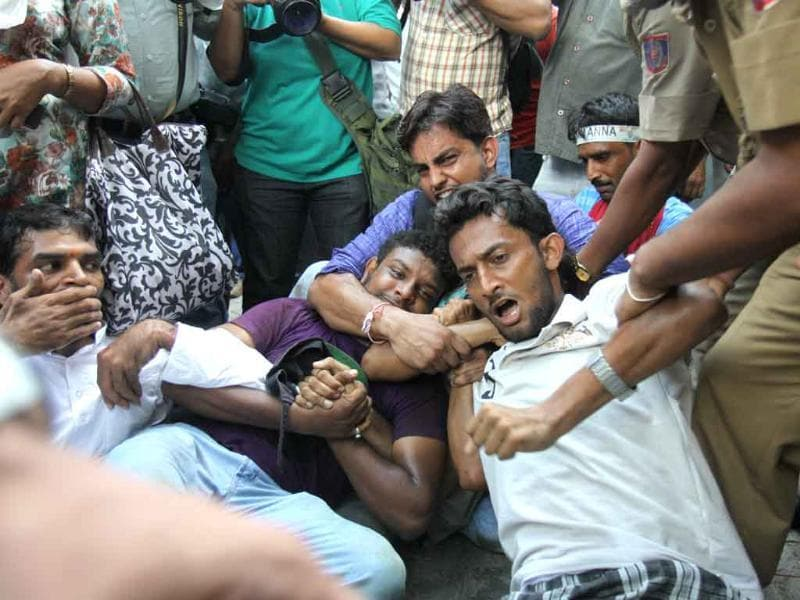 Delhi police personnel detain supporters of anti-corruption activist Anna Hazare during a protest outside the residence of Prime Minister Manmohan Singh in New Delhi.