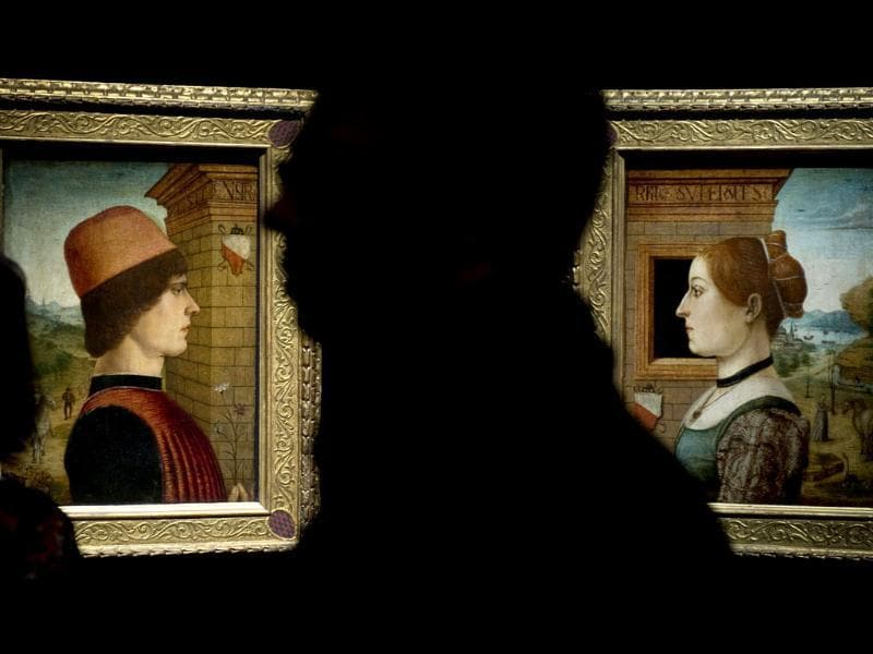 Visitors look at two portraits Portrait of a Man (L) and Portrait of a Woman (R) attributed to the Maestro delle Storie del Pane during a press preview of the exhibition Renaissance Faces - Masterpieces of Italian Portraiture at Berlin's Bode Museum.