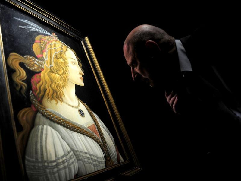 A visitors looks at Italian painter Sandro Boticelli's Portrait of a Lady - Simonetta Vespucci during a press preview of the exhibition Renaissance Faces - Masterpieces of Italian Portraiture at Berlin's Bode Museum.