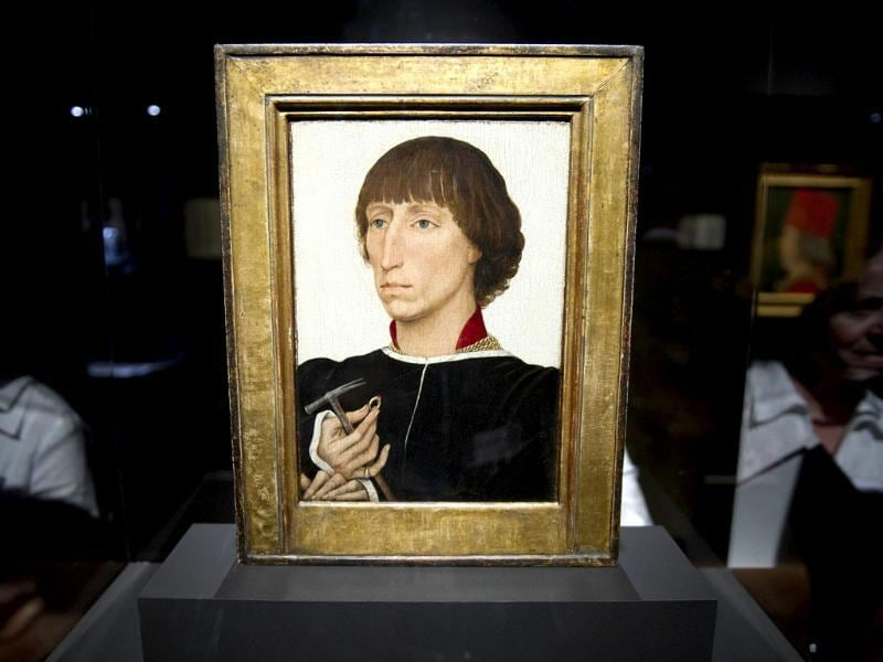 A visitor is reflected in the display case of Belgian painter Rogier van der Weyden's Portrait of Francesco d'Este during a press preview of the exhibition Renaissance Faces - Masterpieces of Italian Portraiture at Berlin's Bode Museum.