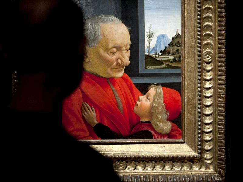 A visitor looks at Italian painter Domenico Ghirlandaio's Portrait of an Old Man and a Boy during a press preview of the exhibition Renaissance Faces - Masterpieces of Italian Portraiture at Berlin's Bode Museum.