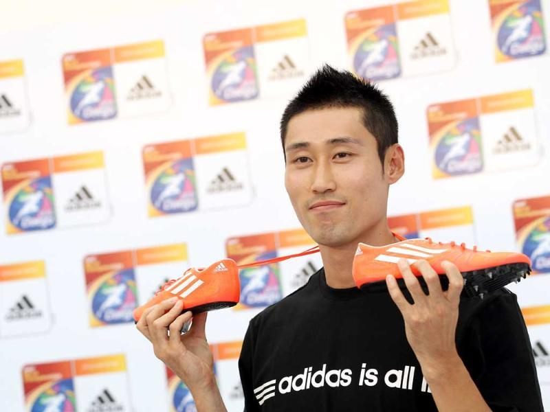 South Korean hurdler Park Tae-Kyung poses with a pair of running shoes during an Adidas press conference in Daegu two days before the start of the World Athletics Championships.